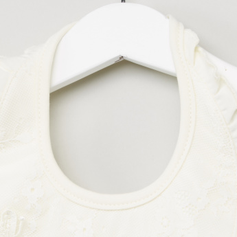 Giggles Embroidered Bib with Ruffle Detail