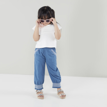 Flat-Front Pants with Embroidery Detail and Frilly Hemline